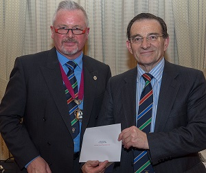 Barry Dibble presents to Frank Norville OBE