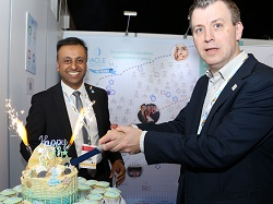 President Dr Shehzad Naroo and Vice President Professor Philip Morgan (right) cut an anniversary cake at the 40th reception.