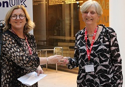 Michelle Acton CEO RSM presenting Irene Stratton with award